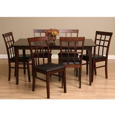 Freshen up the dining room with a seven-piece set of stylish oak dining furniture. This set includes a roomy table, and six chairs upholstered in dark brown bi-cast leather. Seat height of chairs is 18 inches.