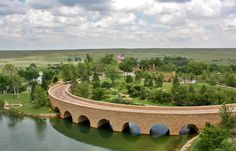 Stone Arches of a Bridge on a Texas Ranch - See more at: http://chambersarchitects.com/blog/231-the-endurance-of-the-roman-arch.html And take a look at more photos like this one at: http://chambersarchitects.com/blog.html