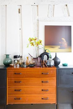 """Sneak Peek: Isabelle Rivoire-Grange. """"The collection of vases is very eclectic yet harmonious. It goes from Arik Levy's golden glass to traditional crystal and all sorts of vintage French or Nordic carafes. I built the piece of furniture myself, adding two sides and nice handles to a 1960s chest of drawers."""" #sneakpeek"""