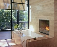 travertine fireplace in the bathroom..um, yes please