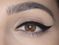 There are all sorts of techniques people use to create a winged eye, but our beauty blogger shows you her favorite way of getting the cat eye look.
