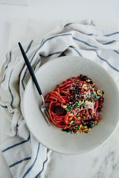 Nothing goes to waste here. Beet tops are made into a pesto and the beets are roasted and folded into the pasta with hazelnuts and parsley.