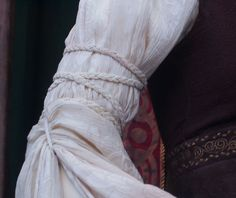 Noticed the rope details on Eowyn's sleeves in LoTR.