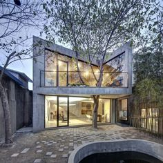 In Shanghai, TEA HOUSE BY ARCHI-UNION ARCHITECTS, great use of backyard space in quadrilateral form, with solid architectural interiors.