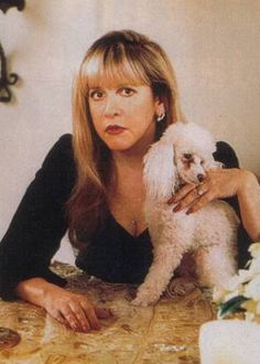 Stevie and her poodle