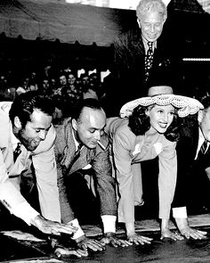 July 24, 1942 — Henry Fonda, Charles Boyer and Rita Hayworth at Grauman's Chinese Theatre in Hollywood, CA.