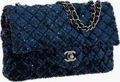 Chanel Stunning Indigo Blue Satin & Sequin Medium Single Flap Bag with Silver Hardware Pristine Condition 10 Width x 6 Height x 3 Depth This highly intricate Chanel bag is done in deep, indigo blue satin with matching sequins sewn on in a classic diamond pattern. Paired with silver hardware, this is an extremely rare bag. The interior is done in indigo lambskin leather and indigo satin. It features one zip pocket.