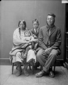 John White Man Runs Him with his wife Amy Yellow Tail, her nephew Beuford Yellow Tail, and their son Arlis - Crow - 1923