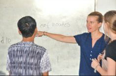 Volunteers Deborah and Lisette correcting an exercise for their student. #teachingabroad