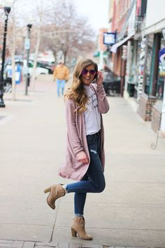 The cutest purple/pink cardigan for spring paired with my Oh Darling Let's Explore the World tee! I love this tee because it matches my wanderlust! I paired it with my favorite ripped jeans and tan suede booties. Plus of course my pink ray bans! By Lauren Lindmark on Daily Dose of Charm