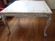 White distressed square table with four matching chairs