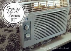 Dressing Up A Window Air Conditioning Unit . using cardboard, cotton batting & fabric, also helps reduce the heat coming through the plastic vents . Window Ac Cover, Door Window Covering, Window Ac Unit, Ac Unit Cover, Framed Fabric, Fabric Frame, Ac Units, Appliance Repair, Diy Frame