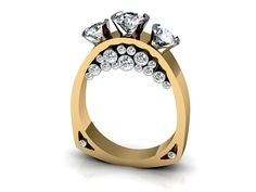 Kennington Jewelers Custom: two tone three stone ring with smaller round cut diamonds throughout the shank.