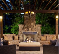 "Traditional patio in Charlotte with a fire feature and a pergola.   Backyard ""wall"" with a fireplace is awesome — mockingbirdi"