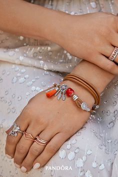 Create one-of-a-kind bracelet stylings with our new limited edition designs. Combine the tan leather bracelet with sterling silver charms or play it cool with tassel dangles, the season's must-have style.