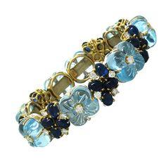 Carved Blue Topaz Sapphire Diamond Gold Flower Bracelet | From a unique collection of vintage more bracelets at http://www.1stdibs.com/jewelry/bracelets/more-bracelets/