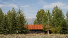 CLB Architects co-founder Eric Logan has renovated his self-designed home in Jackson, Wyoming, adding a cold-rolled steel gabled roof and a new kitchen. Teton Mountains, Rocky Mountains, Garage House, House Roof, Glazed Walls, Corten Steel, Mountain Homes, Architect House, Months In A Year