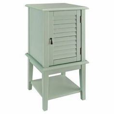 """Aqua accent table with a louvered door and interior shelf.   Product: TableConstruction Material: MDF and solid woodColor: AquaFeatures:  Stylish focus or complementShutter style doorInterior shelf behind door Lower shelf adds storage spaceDimensions: 30"""" H x 15.75"""" W x 15.75"""" D"""