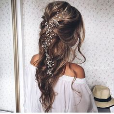 A relaxed loose wedding hairstyle from Modern Salon via Instagram.