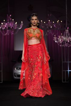 Red pink Indian bridal lehenga by Falguni & Shane Peacock. More here: http://www.indianweddingsite.com/bmw-india-bridal-fashion-week-ibfw-2014-falguni-shane-peacock-show/