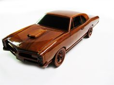 A true classic, the 1966 GTO stands out as the favorite vehicle of an entire generation. This scale model replica in solid mahogany is handcrafted with fine details, deep wood grain and multiple coats of polyurethane finish. Wooden Toy Cars, Wooden Truck, Wood Toys, Fine Woodworking, Woodworking Projects Plans, Mercedes S320, Wood Craft Patterns, Kids Wood, Wooden Gifts