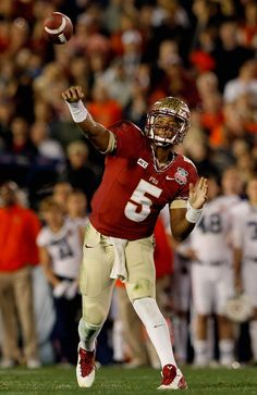 Quarterback Jameis Winston #5 of the Florida State Seminoles throws a pass against the Auburn Tigers during the 2014 Vizio BCS National Championship Game at the Rose Bowl on January 6, 2014 in Pasadena, California.