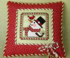 Snowman and Friend is the title of this cross stitch pattern from The Sweetheart Tree. The price includes the pattern and button pack and is stitched with DMC threads.