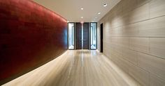 The Edgewater. Striated limestone. Curved leather wall