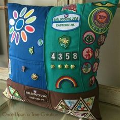 Great way to enjoy your Girl Scout memories! Girl Scout Memory Pillow designed from the Daisy bib, Brownie vest, and Junior sash. The other side of the pillow includes the backs! Girl Scout Vest, Girl Scout Uniform, Girl Scout Badges, Girl Scout Swap, Brownie Girl Scouts, Girl Scout Troop, Girl Scout Cookies, Boy Scouts, Scout Leader