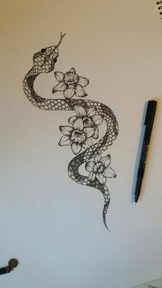 Snake with narcissus flowers ~ cool tattoo #CoolTattooIdeas