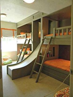 Amazing childrens room with bunkbeds and a slide! Great idea if you have limited space and a big family! #Kidsroom #Fun #DIY