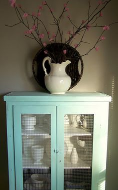 Turquoise cabinet and tissue paper flowers