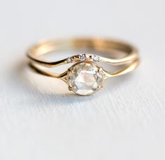 Diamond Corset Ring + Curved Wedding Band ~ rose cut white diamond, cinched ring band by Melanie Casey Pretty Wedding Rings, Wedding Rings Solitaire, Morganite Engagement, Engagement Ring Cuts, Rose Gold Engagement Ring, Bridal Rings, Vintage Engagement Rings, Handmade Engagement Rings, Vintage Wedding Ring Sets