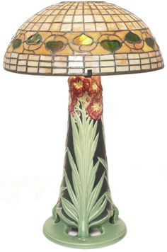 "Exceptional Tiffany Studios/ Rookwood lamp, Rookwood base is beautifully carved and modeled by Kataro Shirayamadani with an intricate and colorful floral design from 1903, base is signed and numbered 645Z and supports a Tiffany Studios leaded glass shade with leaf and vine design, shade signed Tiffany Studios New York, base with a paper label from the Louisiana Purchase Exhibition St. Louis 1904, 14""w x 22""h"