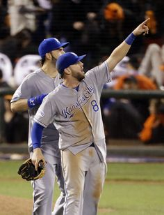 Were Royals slowed down by Game 4 wet field conditions? Kansas City Royals' Mike Moustakas celebrates after the Royals' 3-2 win over the San Francisco Giant... - (AP Photo/Charlie Riedel