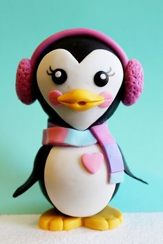 This little penguin lady is my fondant Valentine. She'll go on a Winter Wonderland Cake this weekend…but, I was feeling the love today…so, I added the tiny pink heart. Cheers!