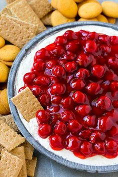 This 4 ingredient cherry cheesecake dip is light, fluffy and so delicious! Serve with graham crackers and cookies for a fun appetizer or dessert.