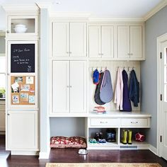 White on white wondrous storage for the entry hall or the kitchen; again, seems easy w/ stock cabinets.  And what a cozy home for Fido! Cabinet doors keep things looking neat and the cork and chalk board keeps all those important pieces of info close at hand.