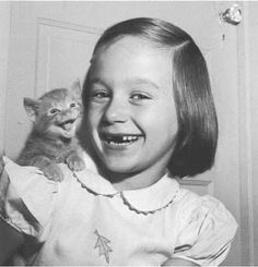 So cute!! I don't know which is cuter...her missing teeth or the little kitty on her shoulder...adorable...