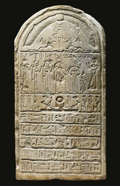 AN EGYPTIAN LIMESTONE ROUND-TOPPED STELA, PTOLEMAICPERIOD, 305-30 B.C. carved in sunk relief with the figure of the deceased, named Hor, Servant of the god Neferhotep, his hands raised in prayer before Osiris, the Theban Triad, and Anubis, a winged scarab with uraei and figures of Anubis above, a solar barque flanked by figures of Maat and five lines of inscription below.
