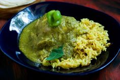 20 Spicy Soups and Stew Recipes To Keep You Warm: Chicken Stewed in Tomatillo-Chilaca Salsa and Served with Turmeric-Oregano Rice