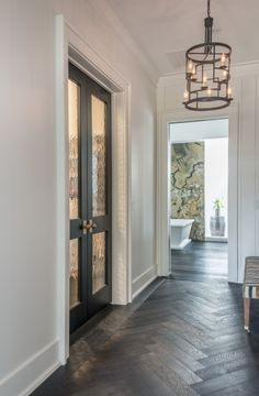 herringbone wood floor accent; seeded doors into study