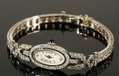 14K gold and platinum Vacheron and Constantin ladies' watch, face framed with pieces of black onyx, onyx crown, V+C movement