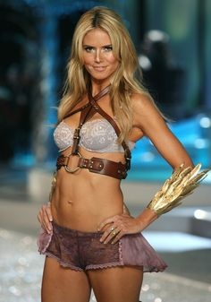 91168a8dc7 Heidi Klum - Any mom who doubled as a Victoria s Secret model for years  pretty much gets an automatic pass into the Hot Mom Club.