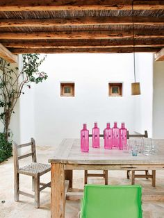 I can't help but fall for this white washed family home in Ibiza with pops of colour.