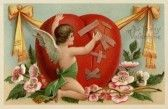 A vintage Valentines card with a cherub patching up a broken heart stock photography