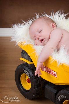 Baby boy with his Tonka truck newborn photo photography... Just minus the fluffy pillow- need something more manly