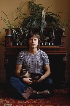 Terry Gilliam screenwriter animator director and 'Monty Python' actor sitting with a cat 1972