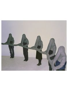 Clarina Bezzola, Connector Suits, 2001 81 fabric suits which zip together. This piece illustrates the close but alienated connection between the wearers.