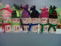 Recycles Coffee Creamer containers,with child's gloves for stocking caps...mate is inside.Scarfs made with strips of felt.Great for using as a container for small toys or special yummy treats.
